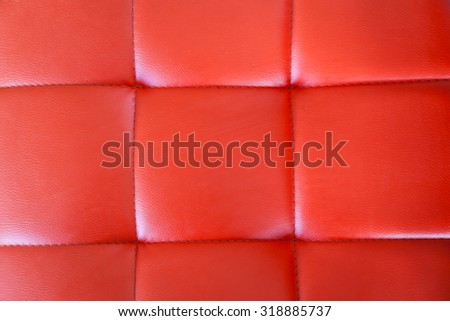 Red leather upholstery - stock photo
