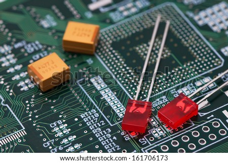 Red LED on green PCB - stock photo