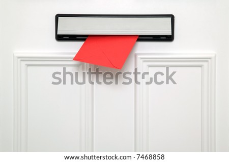 Red letter coming through a chrome letterbox on a white door. Could be a Valentines, Christmas, Birthday or other greetings card. - stock photo