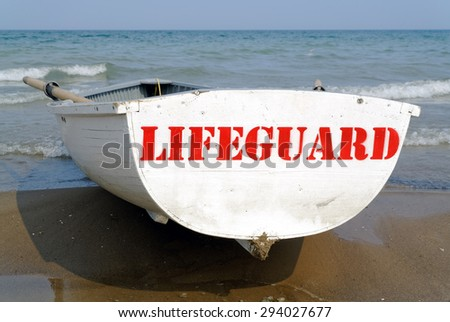 red Lifeguard sign on boat - stock photo