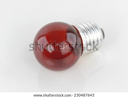 Red light bulb on white background - stock photo