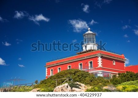 Red lighthouse in a clear sunny day - stock photo