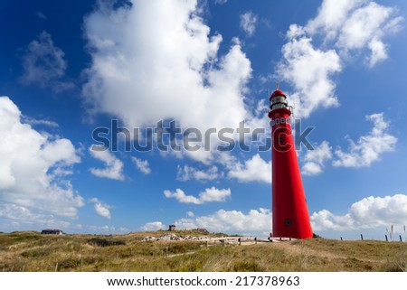 red lighthouse oer blue sky, Schiermonnikoog, Friesland - stock photo