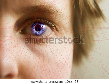 Red lines scanning the face and retina of a woman with the word 'Scanning...' in a text box - stock photo