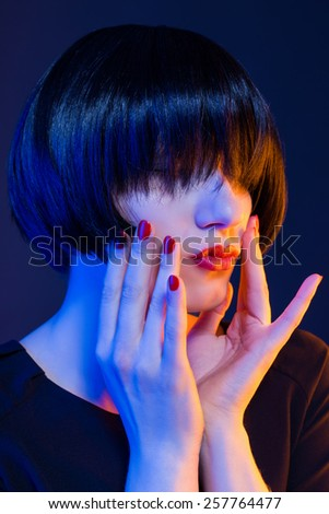 red lips and red lipstick. girl in studio - stock photo