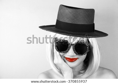 Red lips in black and white, Glamor stylish beautiful young woman model with red lips and hipster sunglasses, Young sexy girl in brown summer hat, High Fashion look, Girl Party. - stock photo