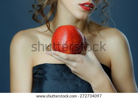 Red lips with red apple. Young woman spring studio shot. - stock photo