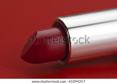 red lipstick on red background - stock photo
