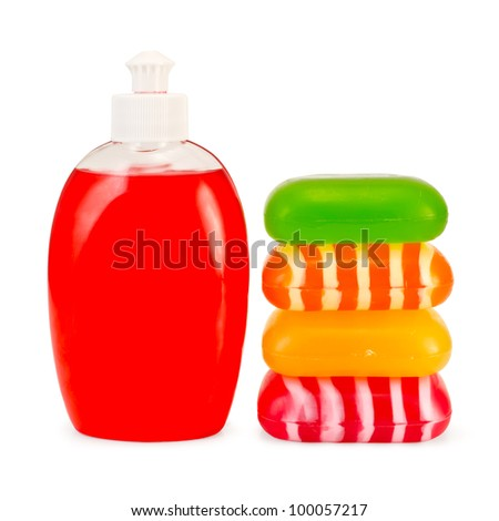 Red liquid soap in a bottle, a stack of solid red, green, yellow and striped soap isolated on white background - stock photo