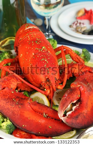 Red lobster on platter on serving table close-up - stock photo