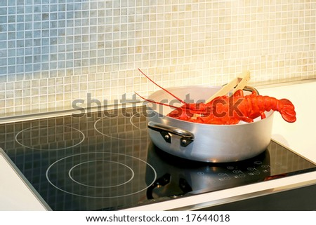 Red lobster steaming in pot on hob - stock photo