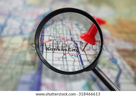 Red locator pin in a Kansas City Missouri map with magnifying glass                                - stock photo