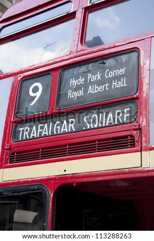 Red London Bus Directions showing Trafalgar Square; Hyde Park Corner; Royal Albert Hall - stock photo