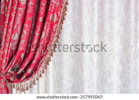 Red luxury curtain and white tull - stock photo