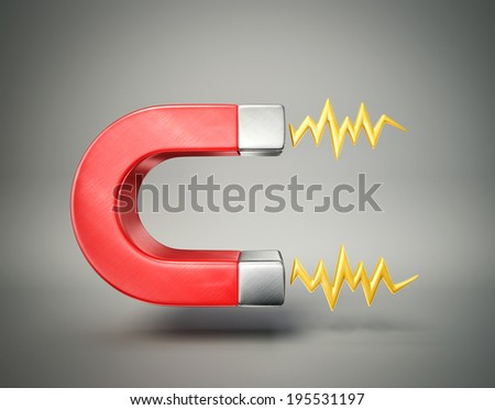 red magnet isolated on a grey background - stock photo
