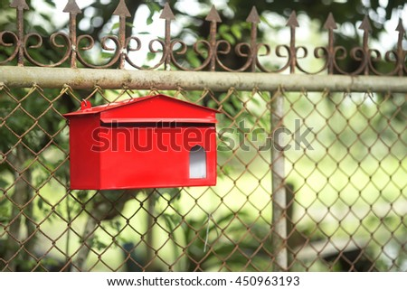 Red mailbox with green background - stock photo