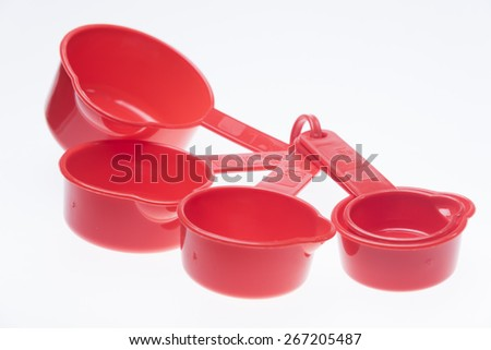 red measuring Spoons Over White Background - stock photo