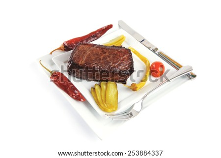 red meat and peppers on white plate with tomato - stock photo