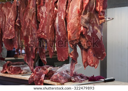 red meat hanging at the markets in Lima Peru - stock photo