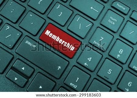 Red membership button on laptop keyboard - stock photo