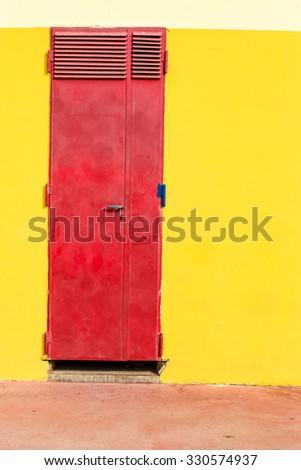 Red metal closed door - stock photo