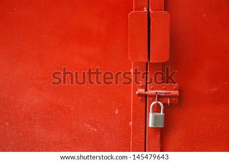red metal door with padlock - stock photo