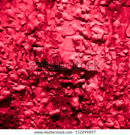 Red metal knobby surface. Vintage abstract background. - stock photo