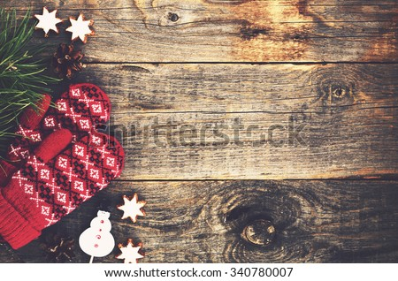 Red mittens on wooden background - stock photo
