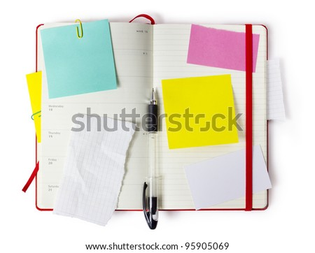 red Moleskin notebook  or calendar or organizer with precise clipping path - stock photo