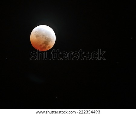 Red moon in total eclipse/Blood Moon/ Total eclipse of the moon on October 8,2014 - stock photo