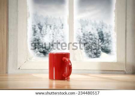 red mug window and winter time - stock photo