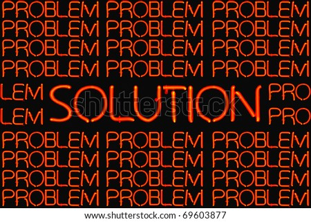 Red neon sign of a solution amongst problems. - stock photo