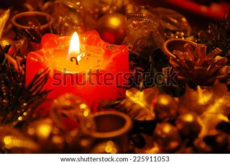red new year burning candle in gold decoration background - stock photo