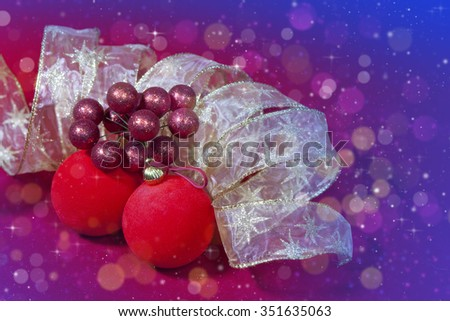 Red New Year's balls and ribbon - stock photo