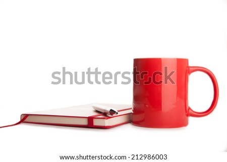 red notebook, pen and cup of tea on white background  - stock photo
