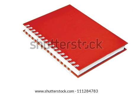 Red notebook spiral bound on white - stock photo
