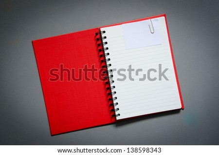 red notebook with papernote - stock photo