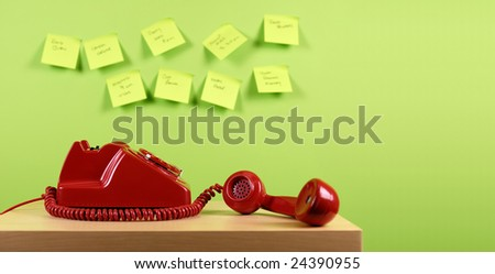 Red office telephone. Busy office concept. - stock photo