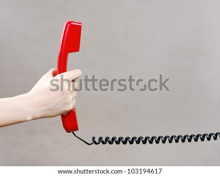 Red old fashioned style telephone handset receiver and arm - stock photo