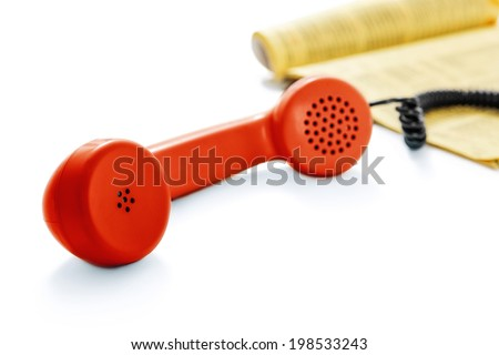 Red old phone and phone directory -Clipping Path - stock photo