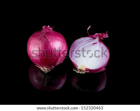 Red onion isolated on black background with reflection. - stock photo