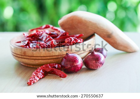 red onions and dried chili natural light with blurred background effect of trees in the garden. image suitable for restaurants, supermarkets, wholesalers, resellers products or health products  - stock photo