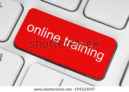 Red online training button on white keyboard background  - stock photo