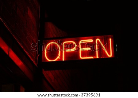 Red open neon sign glowing in the night - stock photo