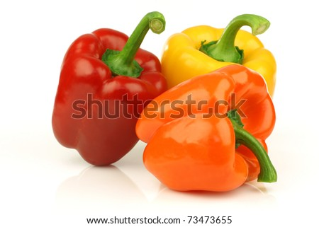 red, orange and yellow bell pepper(capsicum) on a white background - stock photo