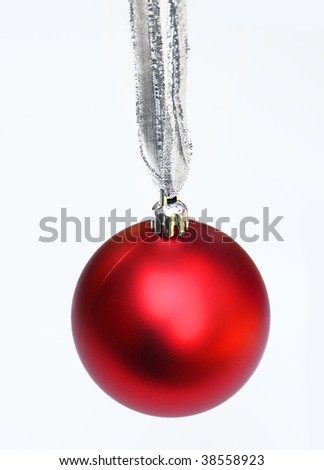 Red ornament on silver string - stock photo