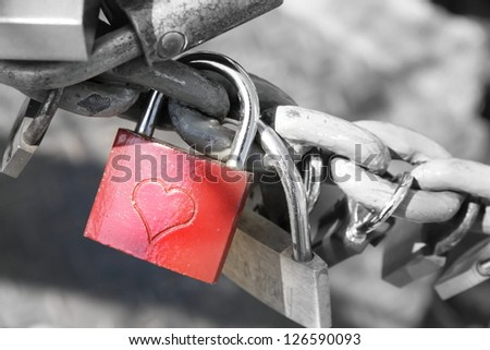 Red padlock with an engraved heart/Promise of Love - stock photo