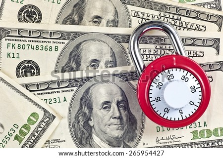Red PadLock With Lots Of Cash Fictitious/ Financial Security Concept - stock photo