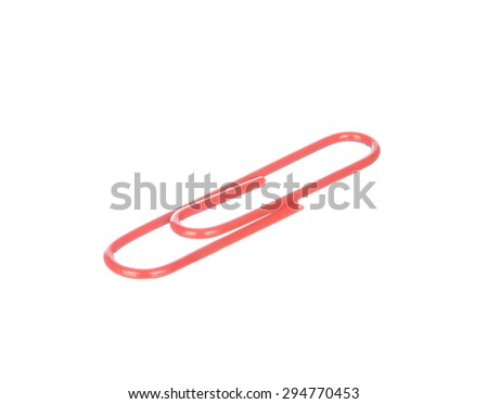 Red paper clip isolated on white background - stock photo
