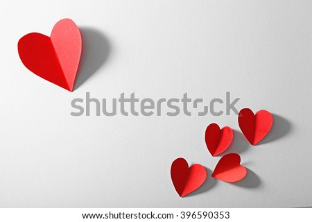 Red paper heart isolated on white background with copy space - stock photo